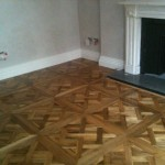 Installation of wood floor panels